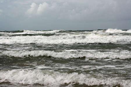 the seas: north sea waves crashing to shore along coastline Stock Photo