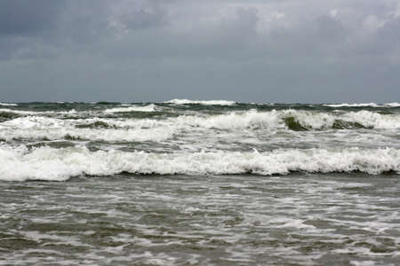 crashing: north sea waves crashing to shore along coastline Stock Photo