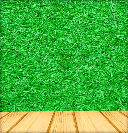 textuur: houten plankenvloer en kunstmatige groene gras