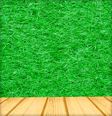 background texture: wood plank floor and artificial green grass