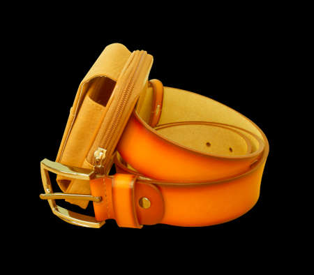 leather bag: Leather belt and leather bag isolated on a black background.