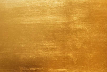 brushed: Gold background or texture and gradients shadow. Stock Photo