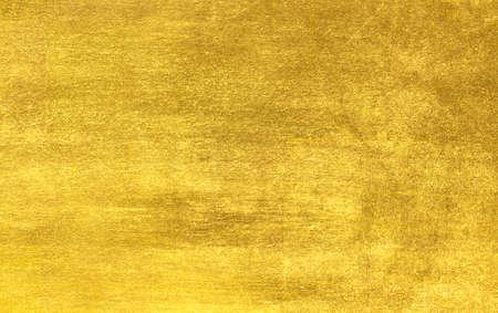 光沢のある黄色の葉金箔テクスチャの背景 写真素材
