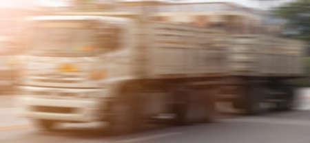 Industrial land transport truck blur.
