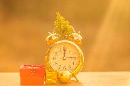 Golden clock with gifts