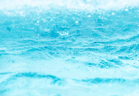 Blurred water, glittering bokeh