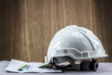 An engineer hat on the desk background