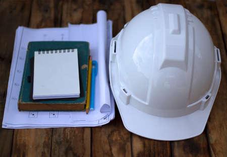 Engineer cap on wood background industrial Reklamní fotografie