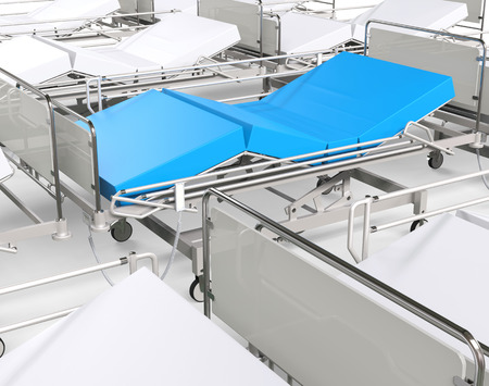 healing practitioners: White hospital beds - focus on blue one