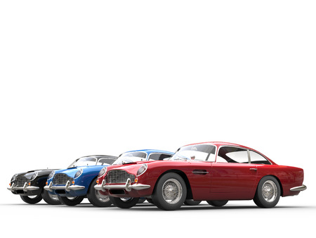Red, blue and black vintage cars - studio shot