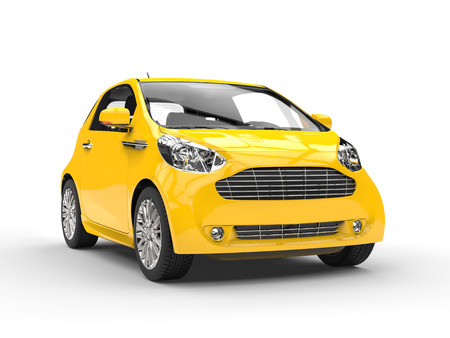 Small Yellow Compact Car - Front Headlight View Stock Photo
