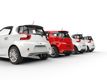 Row of compact cars - red stands out - back perspective view