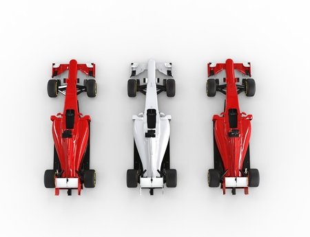 Red and white Formula racing cars - top view.