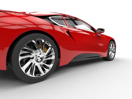 Moderne voiture de sport rouge - gros plan de la roue arrière - isolé sur blanc