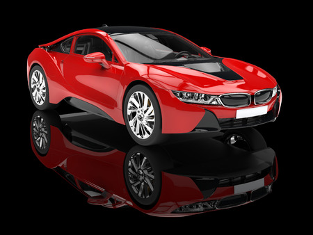 Modern red sports car - isolated on black reflective background. Stock Photo