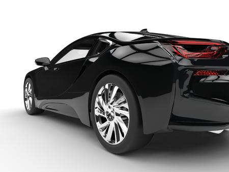 Moderne zwarte sportwagen - achterwiel closeup - geïsoleerd op wit