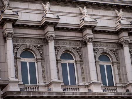 decorative balconies: Building facade with large columns and ornaments