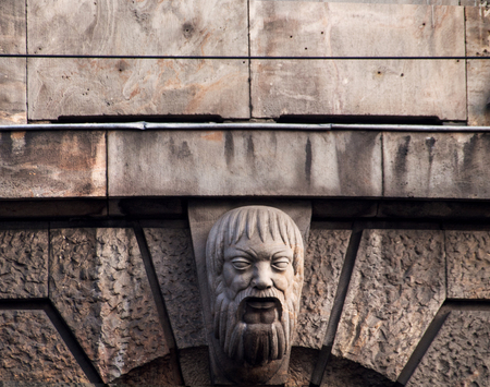 old building facade: Ornament head on the old  building facade