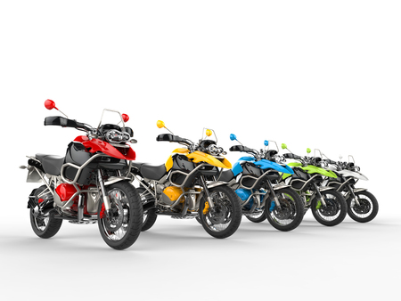 Colorful motorcycles on a starting line Stock Photo
