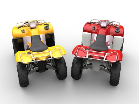 quad: Yellow and red quad bikes - top view