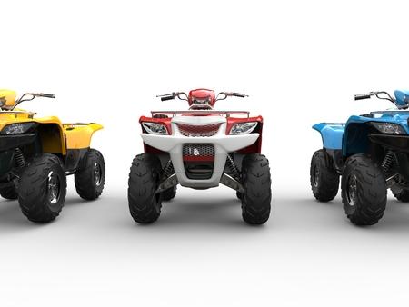 quad: Three quad bikes - front view - cut shot Stock Photo