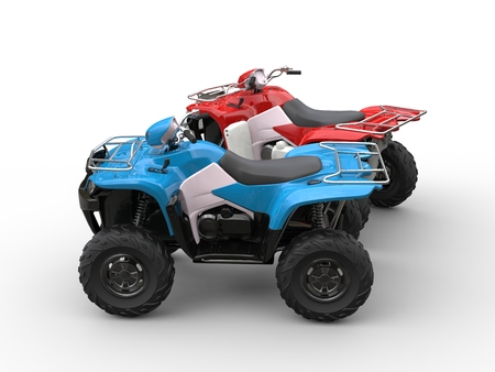 Red and blue quad bikes - side view Stock Photo