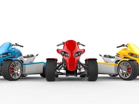quad: Electric quad bikes - cut shot - red quad in focus