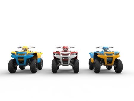 quad: Three quad bikes - front view Stock Photo