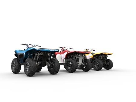 quad: Three quad bikes - back view