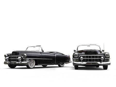 studio lighting: Two awesome black vintage cars - studio lighting shot Stock Photo