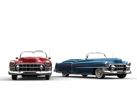 Metallic cherry and royalblue vintage cars - side by side