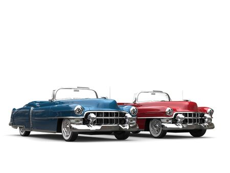 collectibles: Cornflower blue and cherry red vintage cars with white wall tires - side by side Stock Photo