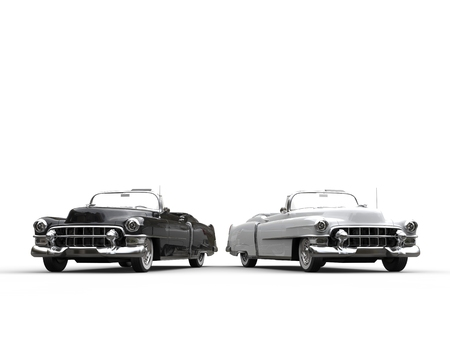 collectibles: Two awesome black and white vintage cars - side by side