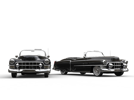 collectibles: Two awesome black vintage cars - side by side