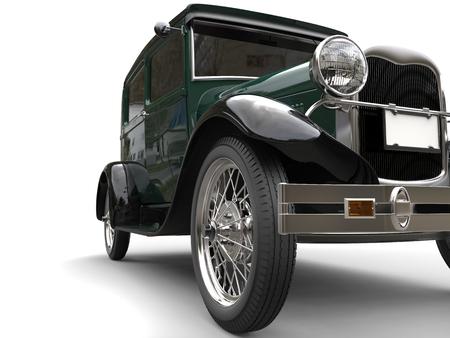 Beautiful dark green vintage car - front wheel closeup