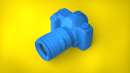 Cool blue photo camera on nice yellow background
