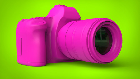 Candy pink camera on fresh green background
