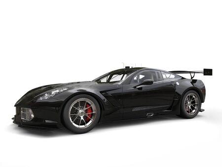 Jet black awesome sportscar - studio shot