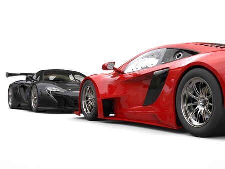 Black and red supercars facing each other - focus on red car