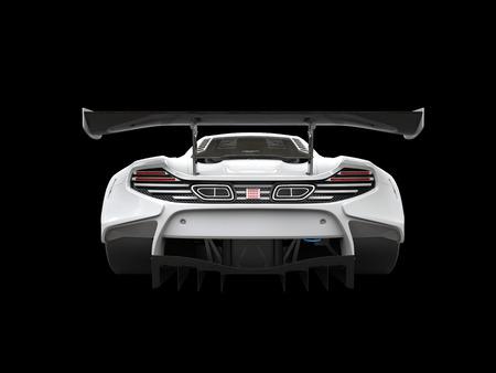 雪の白いモダンなスポーツカー - 背面図