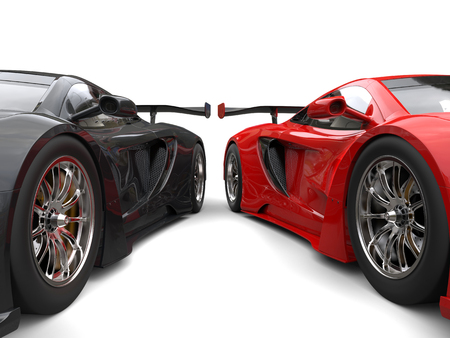 Black and red awesome supercars side by side - wheels closeup shot Stock Photo