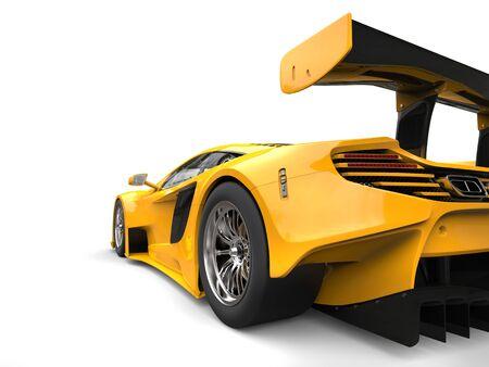 Sun yellow awesome race car - rear wheel closeup shot Stock Photo
