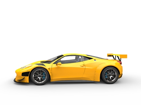 Bright yellow fast super car - side view