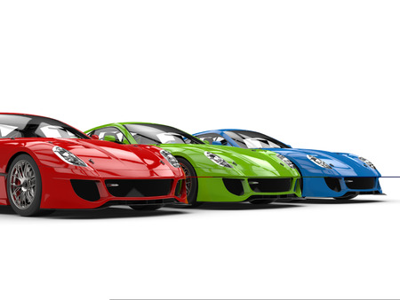 Fast sports cars in red, green and blue - closeup shot