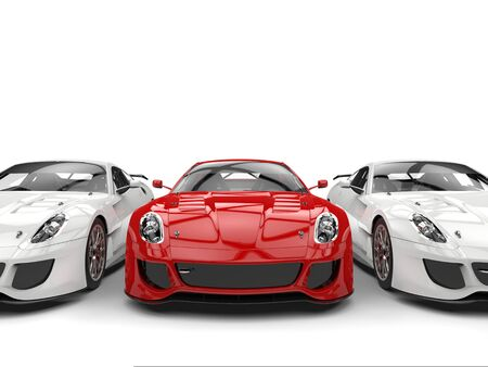 Sublime red sport car in the middle of two white cars