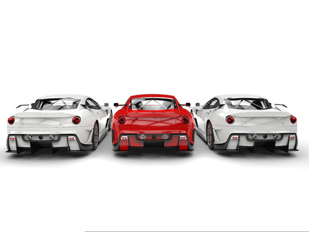 Sublime red sport car in the middle of two white cars - back view Stock Photo