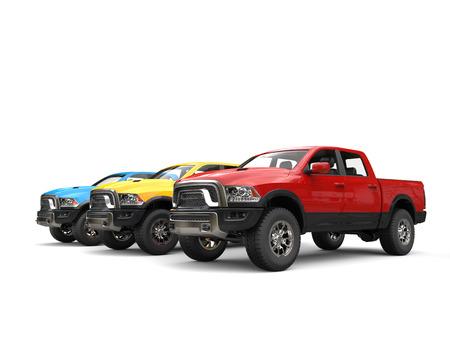 Red, blue and yellow modern pick-up trucks - beauty shot Stock Photo