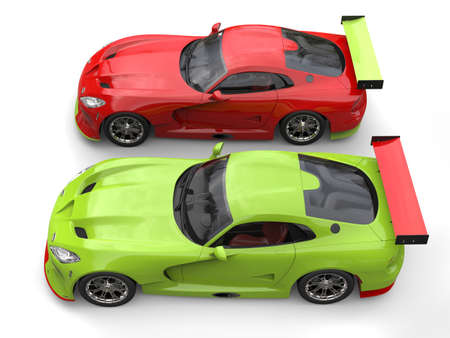 Raging red and crazy green super race cars side by side on start line - top view