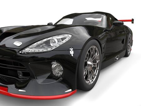 Supercar black with red details - headlight extreme closeup shot