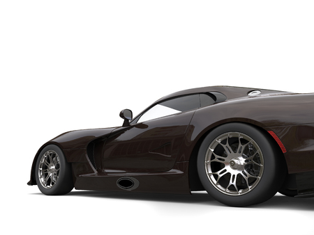 Dark brown fast race car - low angle side view cut shot Imagens